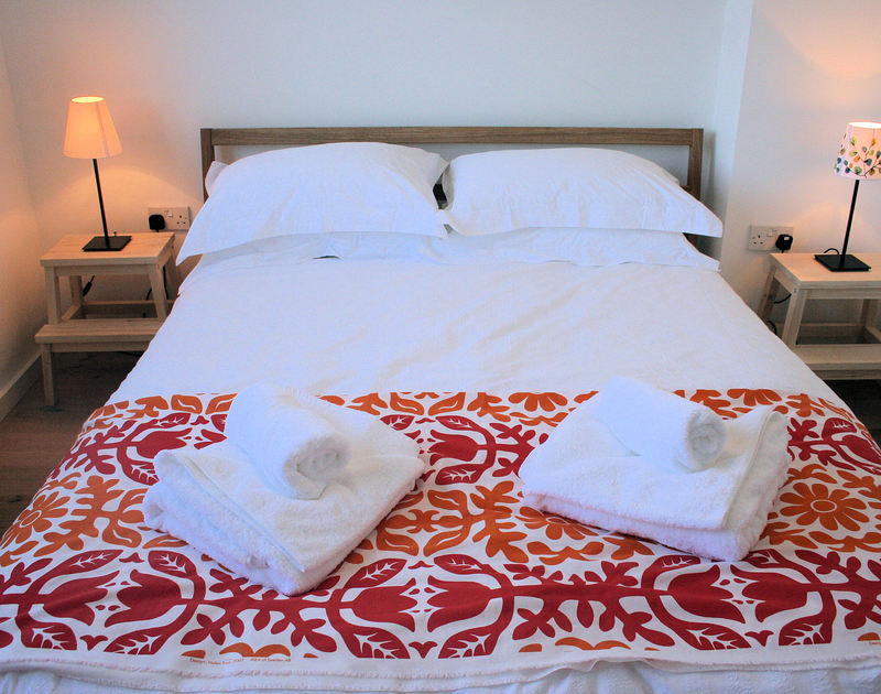 A cosy, pretty double bedroom at Rock Pipit, a luxury self-catering holiday house at Polzeath, Cornwall