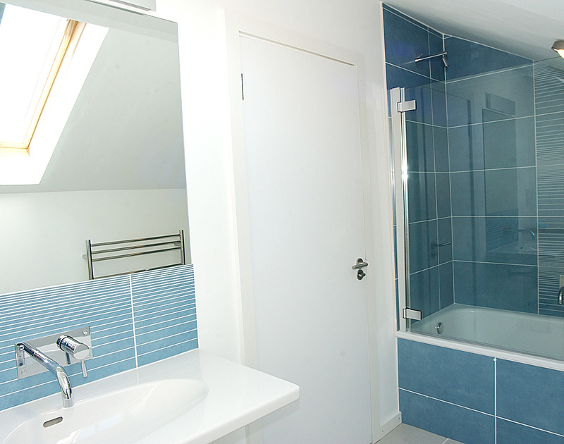 The stylish, blue bathroom at Rock Pipit, a self-catering holiday house at Polzeath, Cornwall