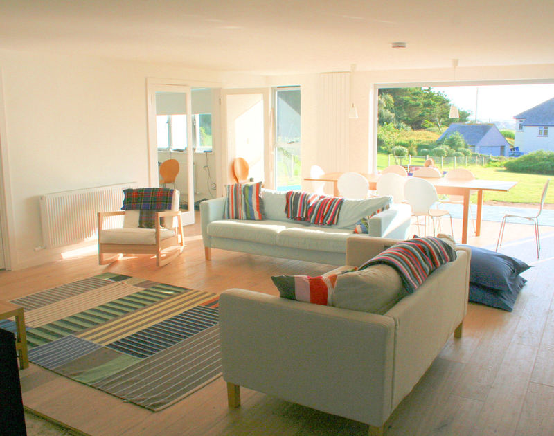 The large, open-plan sitting room of Rock Pipit, a self-catering holiday house at Polzeath, Cornwall