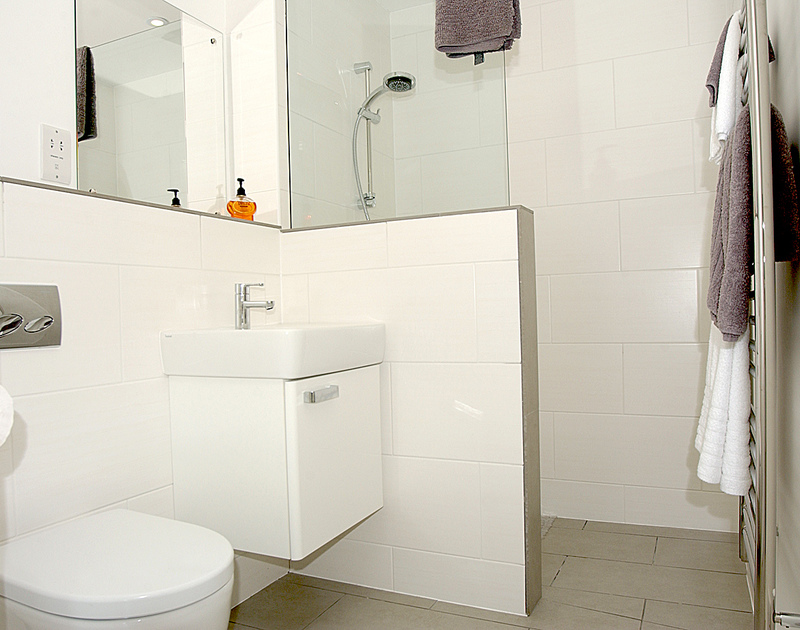 One of the sleek and modern shower rooms in The Beach Hut, a self catering holiday rental in Polzeath, Cornwall.