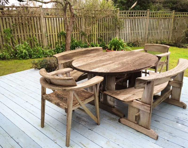 Rustic wooden furniture on the deck at Trewella, a self-catering holiday house at Daymer Bay,