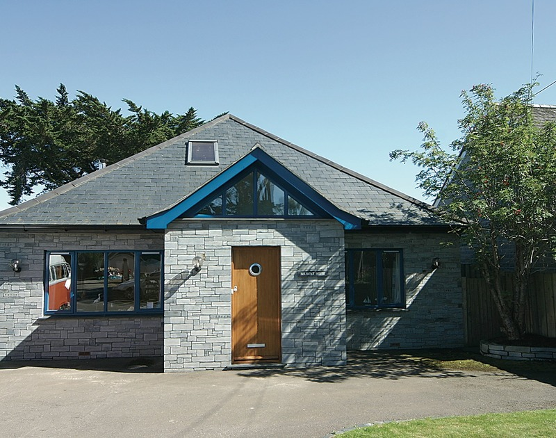 The exterior view of Belmont, a self-catering holiday house in Rock, Cornwall, with ample parking space.