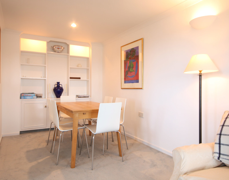 The open-plan dining room of One Slipway Cottage, a self-catering holiday house in Rock, Cornwall