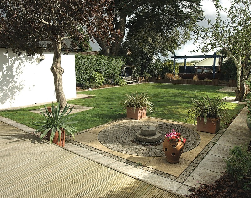 The zen-like landscaped garden at Belmont, a holiday house to rent in Rock, Cornwall with decking and swing seat.