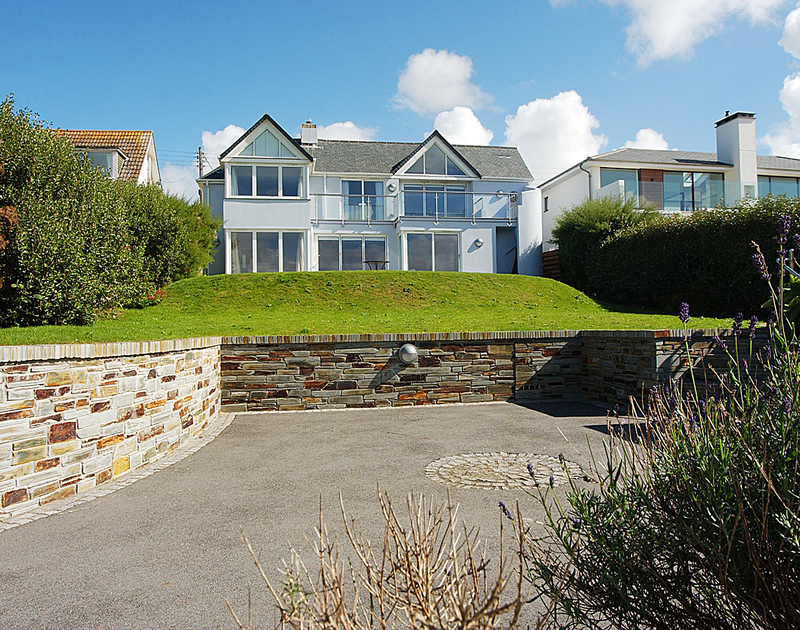 The lawned garden and spacious driveway at Bryher, a holiday house in Polzeath, Cornwall