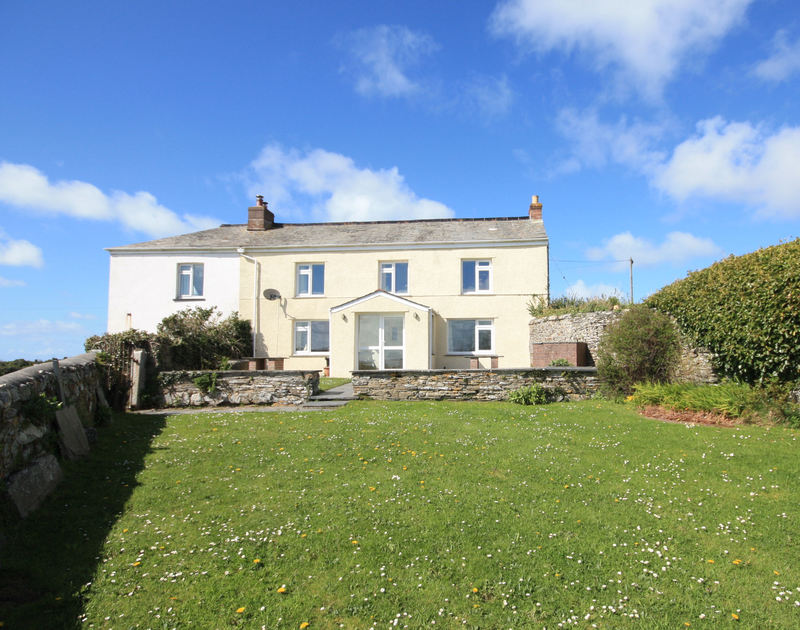 An exterior view of Trewint farmhouse, a family, self catering, holiday house to rent close to Daymer Bay, North cornwall.
