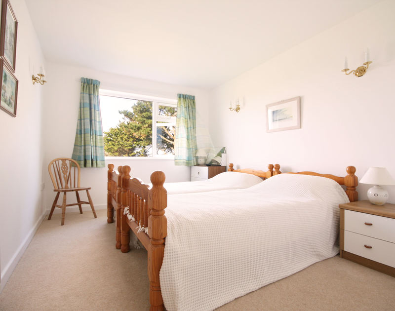 A restful twin bedroom at Broadagogue, a coastal holiday house near Daymer Bay, North Cornwall