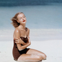 Liz benn models a strapless swimsuit by givenchy