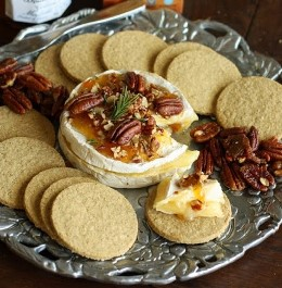 Baked Brie with Plum Preserves and Spiced Pecans