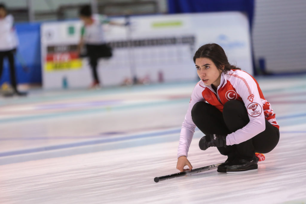 Play-off places set as the world qualification event round robin concludes - World Curling Federation