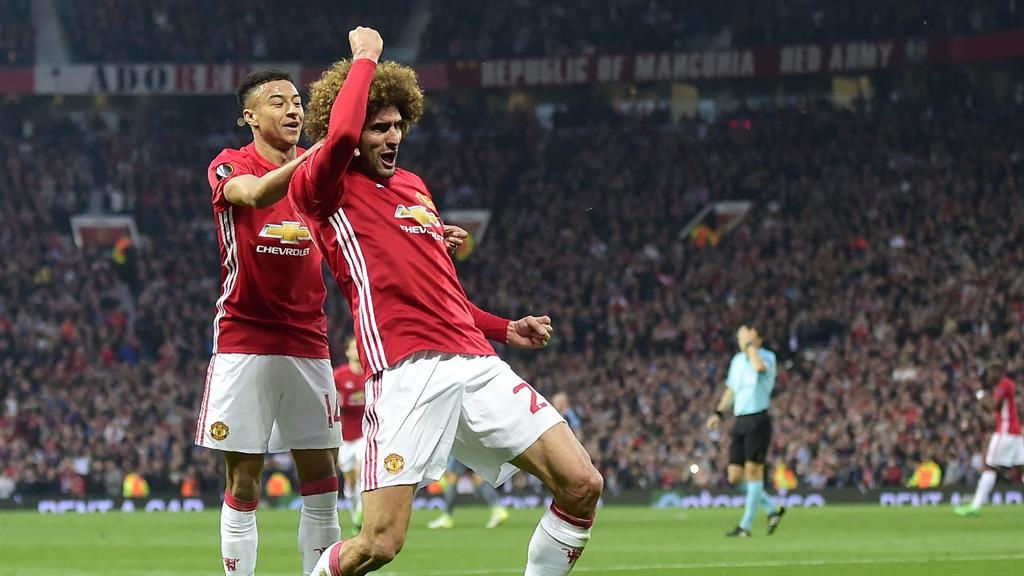 Nervy Manchester United cling on as both teams see red