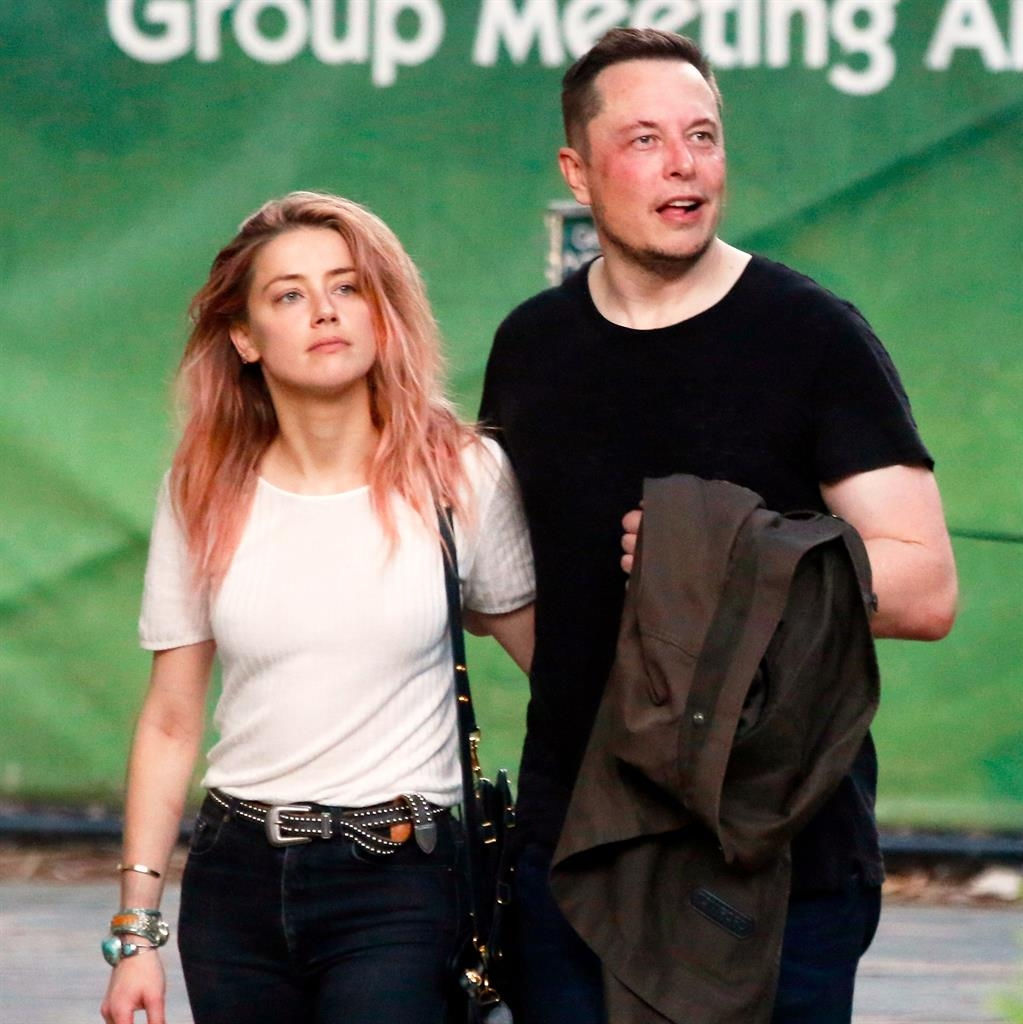 Have You Heard? Elon Musk Wears Amber's Cheeky Lipstick Kiss