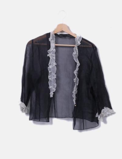 Camisa negra semitransparente volantes