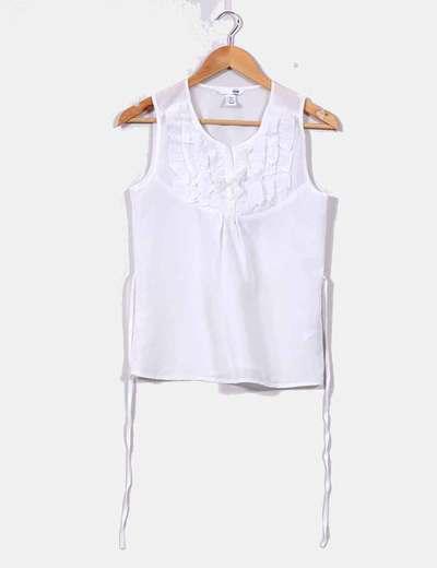 Blusa blanca con volantes en pecho H&M