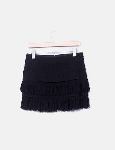 Falda negra con flecos