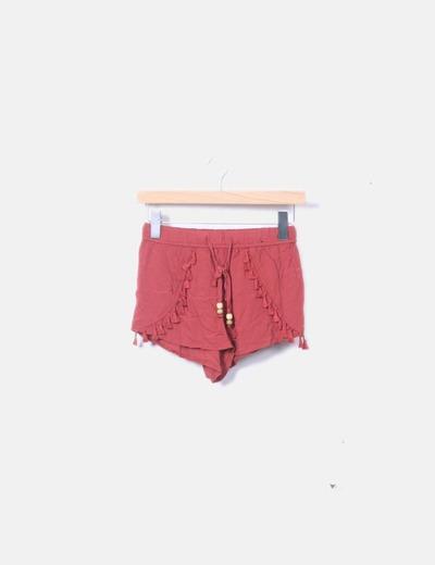 Short rojo con pompones