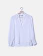 Blusa blanca manga larga escote en pico Zara