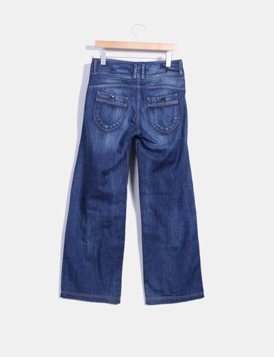Jeans oscuro con pata ancha