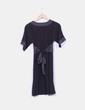 Vestido negro combinado con escote en pico H&M