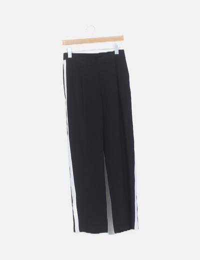 Pantalón baggy negro franja blanca