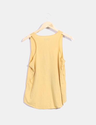 Camiseta amarilla print pluma