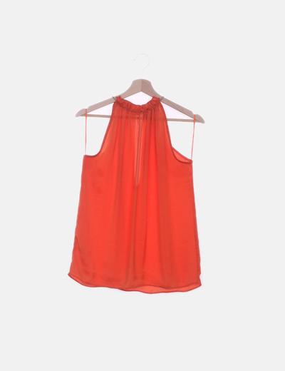 Blusa naranja detalle metalico