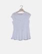 Top tricot peplum blanco con tachas Evima