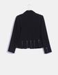 Chaqueta blazer negra texturizada, detalle aberturas Lévana