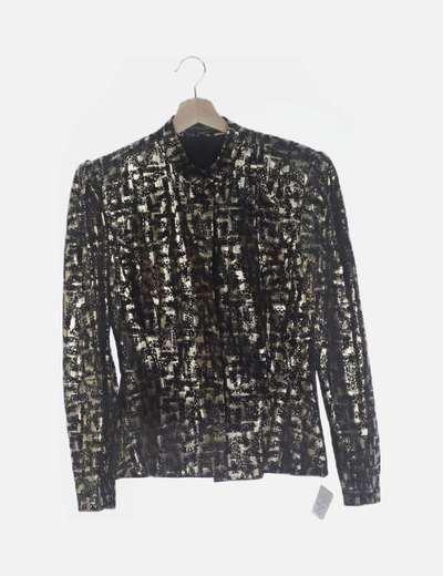 Conjunto falda y chaqueta negra y dorada