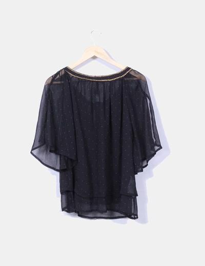 Blusa negra con topos semitransparente
