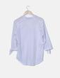 Camisa oversize blanca con topos azul marino Zara