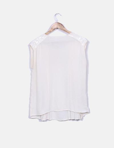 Camiseta beige fluida con pailettes