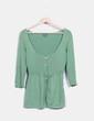 Top tricot verde Trucco