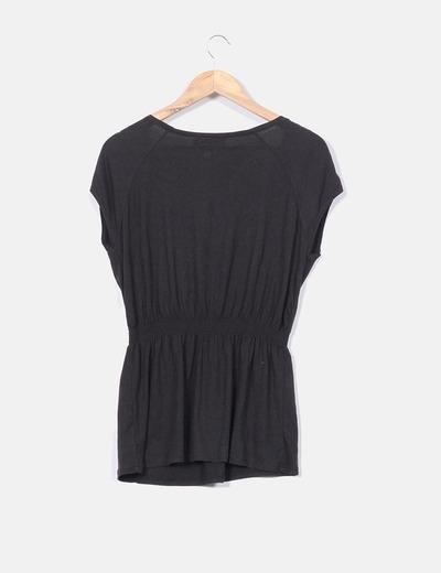 Blusa negra escote pedreria cinturilla elastica