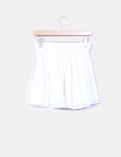 Mini falda cruda bordada