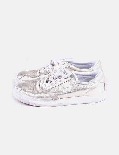 Sneaker dorada