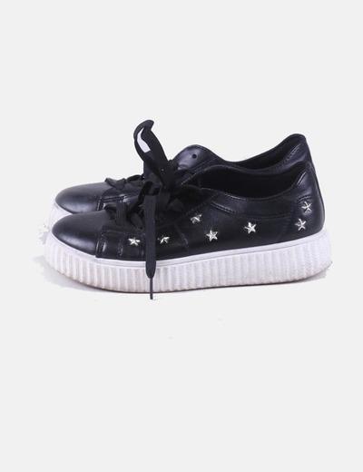 Zapatillas negras con estrellas