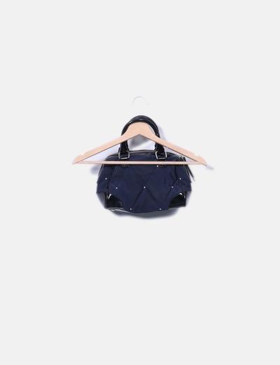Bolso acolchado azul marino combinado con cuero
