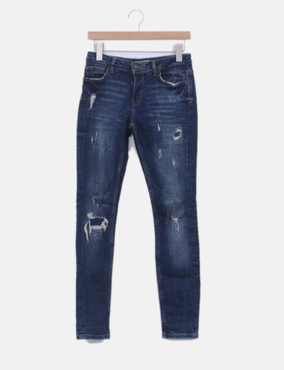 Jeans denim skinny con rotos