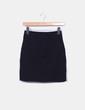 Mini falda elástica negra con cremallera H&M