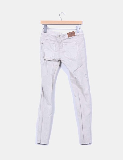 Jeans denim pitillo beige