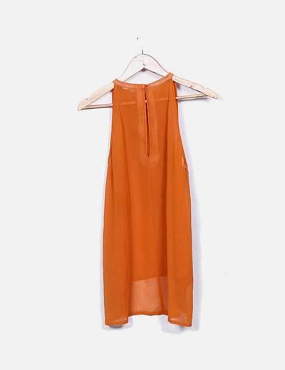 Blusa naranja flecos