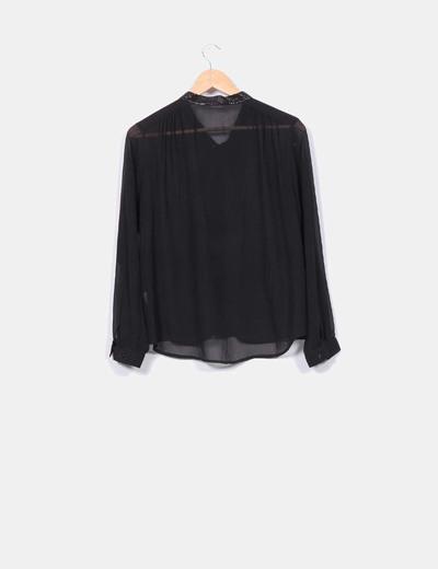 Blusa negra semi transparente con lentejuelas