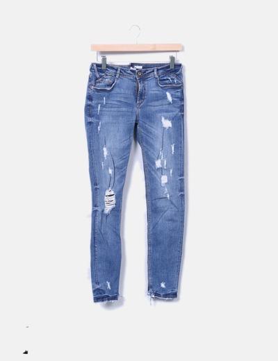 Jeans denim skinny con rotos Zara