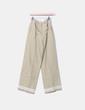Pantalón de tela beige detalle botones dorados NoName