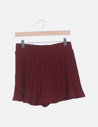 Mini falda plisada roja pata de gallo