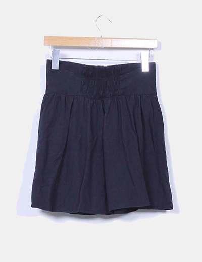 Mini falda azul marino con botones