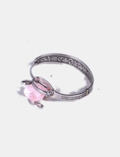 Pulsera plateada con piedra rosa NoName