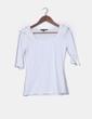 Camiseta basica blanca manga francesa detalle volantes hombros Dunnes