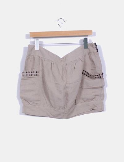 Mini falda beige pedreria
